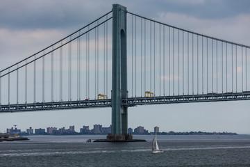 White Sailboat and Suspension Bridge