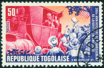 stamp printed by Togo, shows Lafayette arriving in Montpelier