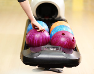 Colorful Bowling balls in ball return