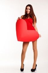 Beautiful woman standing with big paper heart