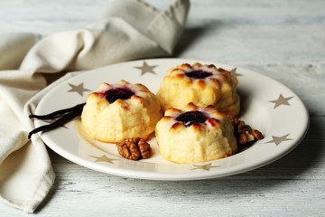 Delicious cheesecakes on wooden table
