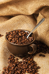Coffee beans in a cup with spoon
