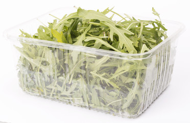 rucola salad in transparent case