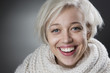 Attractive blond woman smiling charmingly