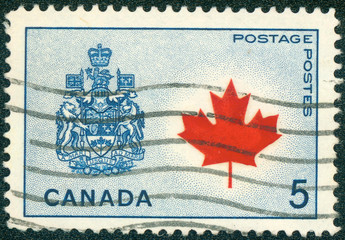 stamp shows Maple Leaf and Arms of Canada