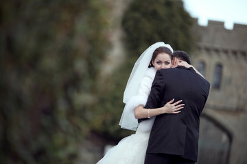 Happy couple embracing. Wedding beautiful bride and groom.
