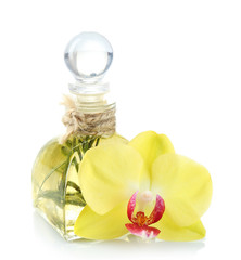 Aroma oil with orchid flower isolated on white