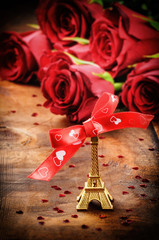 Valentine's setting with Eiffel tower decoration and bouquet of