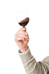 Close up on male hand holding a glass of wine