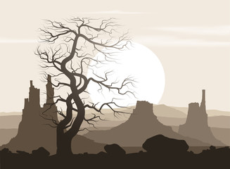 Lifeless landscape with old tree and mountains over sunset.