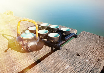 Chinese tea set on a wooden jetty