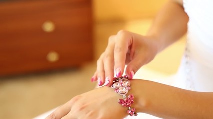 the bride wears wedding jewelry