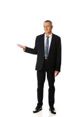 Full length smiling businessman holding copyspace