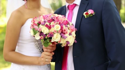 wedding couple are holding bouquet