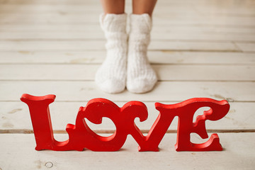 Love letters on the wooden floor with woman legs