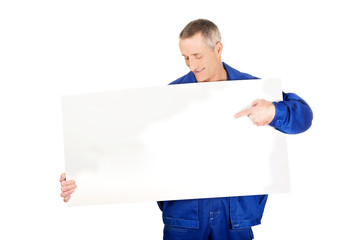 Happy worker presenting empty banner