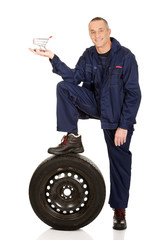 Mechanic with a tire and basket