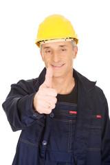 Portrait of happy repairman showing thumbs up
