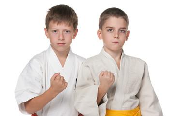 Two serious boys in kimono