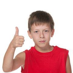 Smiling boy holds his thumb up