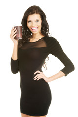 Full length woman holding a cup of coffee