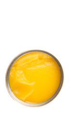 Indian ghee in a tin can over white background