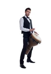 Elegant bearded man plays on percussion