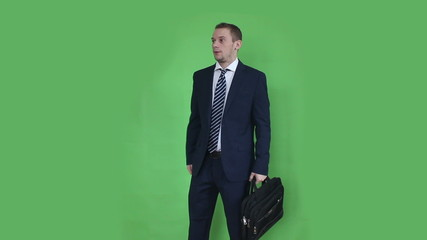 business man waiting with laptop bag green screen