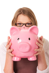 Young woman holding piggybank