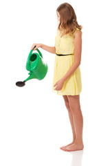 Beautiful young woman with watering can