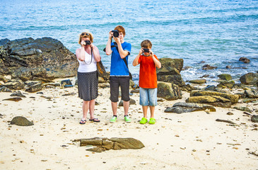 Family takes a photo at the rocky beach