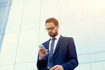 Young broker receiving bad news from exchange
