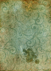 Grunge paper with ornament and paint splatters.