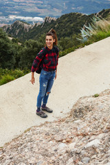 Beautiful backpacker woman laughing while out hiking