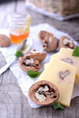 sliced cheeses and walnuts