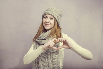 Teen girl and the heart sign