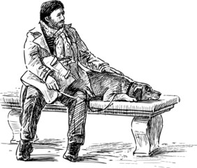 man with a dog on a park bench