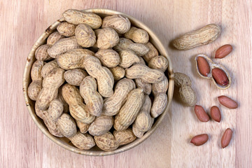 peanuts in a wooden bowl,nut