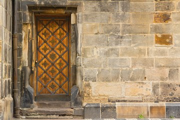 Detail of the old wooden doors in the Old Town of Prague