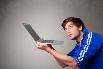 Attractive man holding modern notebook