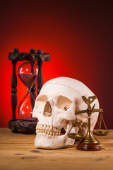 human scull and  scales of justice