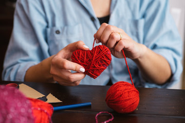 Creating red woolen heart