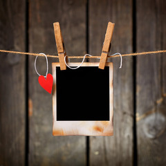 Photo frame with paper heart hang on rope