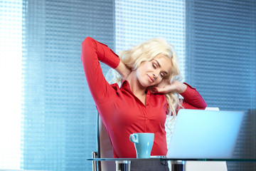 Adult young pretty business woman working at her office.