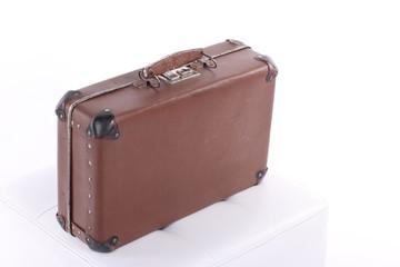 Vintage Suitcase bag old over a white background