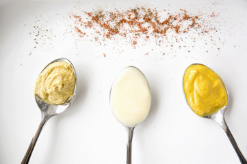 mustard and mayo on spoon