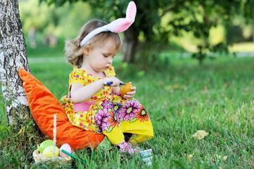 Adorable toddler girl wearing bunny ears