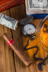 Top view, rich person or bussinesman desk with cuban cigar, bank