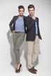 fashion couple posing on light grey background