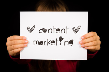 Child holding Content Marketing sign